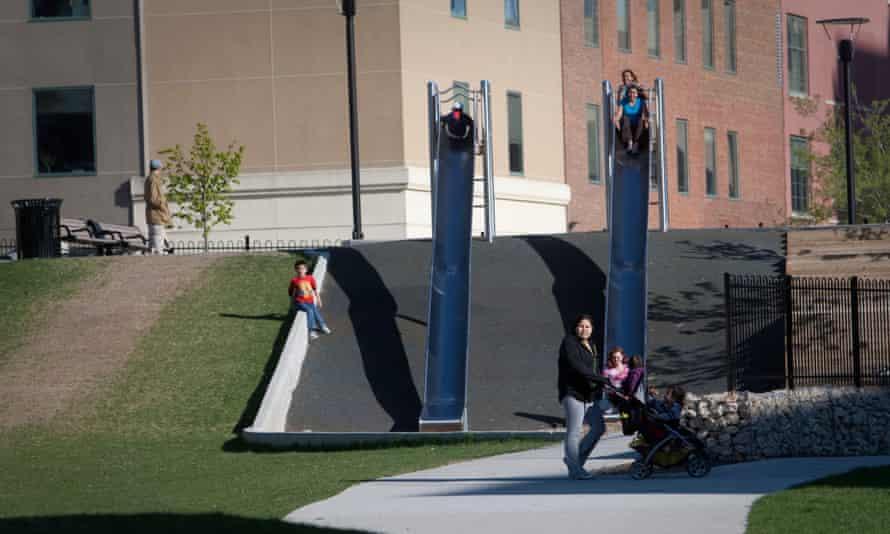 Children use the slides in Central Park, Winnipeg, one of Canada's poorest urban neighbourhoods.