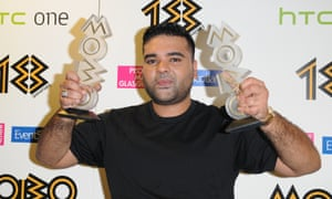 Naughty Boy shows off his best song award for La, La, La, and best video gong at the Mobos in 2013.
