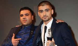 'Our friendship was genuine, 100%' … Khan with Zayn Malik at the Asian awards 2015.