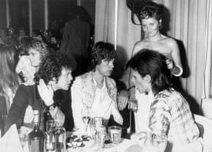 Lou Reed, Mick Jagger, Lulu and David Bowie at a party hosted by Bowie at the Cafe Royal, London, in July 1973.