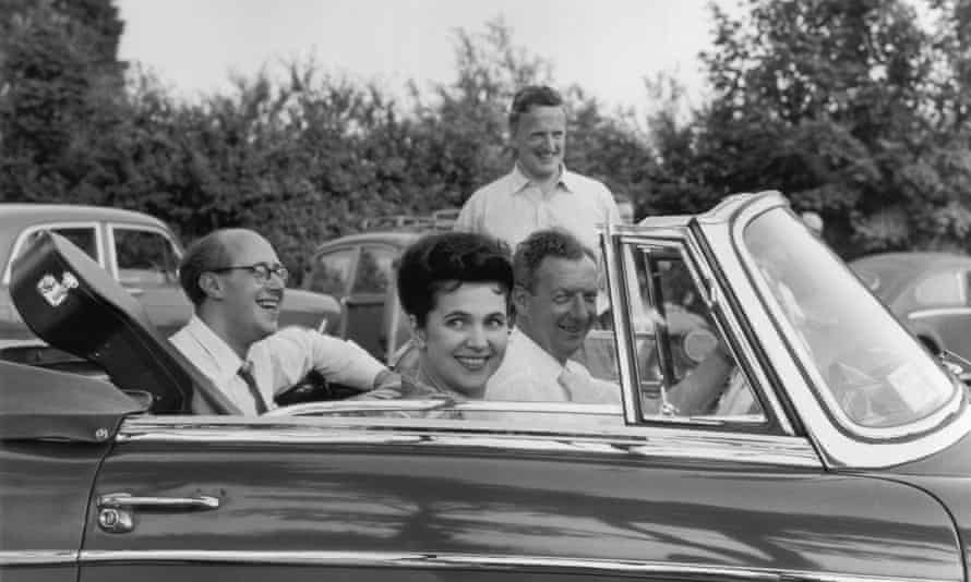 English tenor Sir Peter Pears (in background), with the English composer Benjamin Britten and Galina Vishnevskaya, the wife of cellist and conductor Mstislav Rostropovich (back of car), at the Aldeburgh Festival (founded by Britten and Pears).