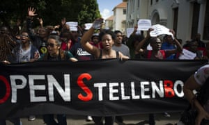 Students hold a banner reading 'Open Stellenbosch' during a protest on 1 September against allegations of racism on campus brought to light by Luister