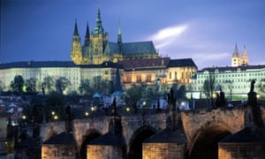 General view of Charles Bridge and Prague Castle at sunset,