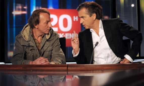 Houellebecq with Bernard-Henri Levy, promoting their book Public Enemies.
