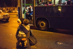 Refugees board buses that will finally take them to Austria after days of being stranded at Keleti Railway Terminus when the Hungarian government cancelled trains bound for Austria and Germany.