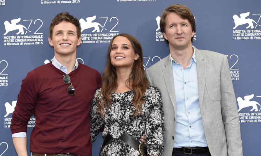 Eyes left ... The Danish Girl actors Eddie Redmayne, left and Alicia Vikander, alongside British director Tom Hooper.