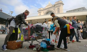 Volunteers help clean up Keleti railway station after many migrants departured Budapest the previous night.