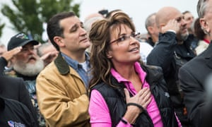 Former Alaskan Governor Sarah Palin (R) and Sen. Ted Cruz (R-TX) recite the Pledge of Allegiance at a rally regarding the government shutdown on October 13, 2013.  Cruz is among the Republican presidential candidates who reject the expert consensus on human-caused global warming.