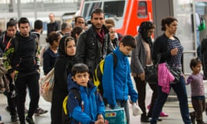 Migrants are brought through the central station in Munich to the registration area