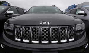 Rain drops rest on the hood of a Jeep Grand Cherokee at Bill DeLuca's dealerships in Haverhill, Mass.