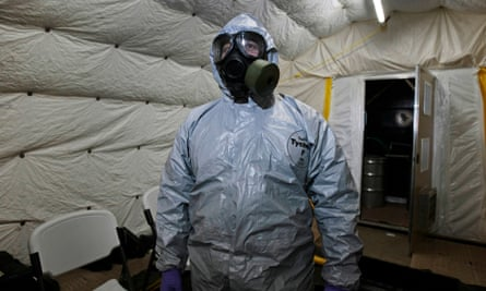 US officer in a chemical weapons disposal suit.