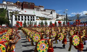 A drum dance phalanx attends a grand ceremony marking the 50th anniversary of the founding of the Tibet Autonomous Region.