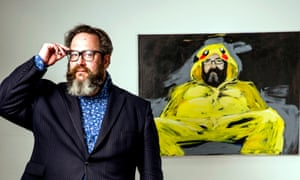 Myles Jackman and a portrait of himself dressed as Pikachu, in his office in central London.