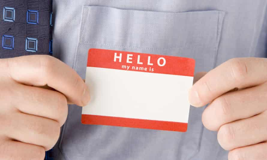 Hands holding name badge