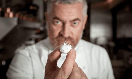 Chef Alex Atala shows off his golden Amazonian ants over a coconut meringue.