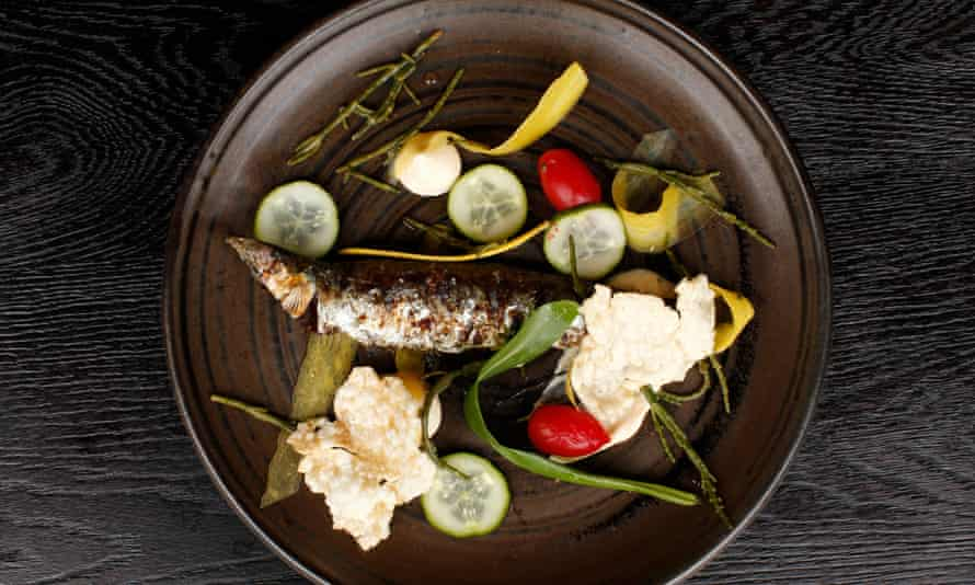 The charred sardine 'comes away easily from the bone because to do otherwise would be bad manners'.