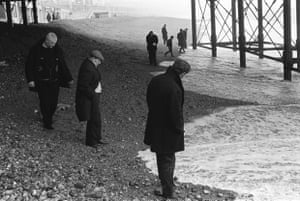 Waiting for money to be washed up in the tide after a storm, Brighton beach, 1970