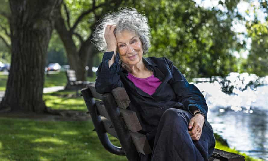 Margaret Atwood sitting on a park bench