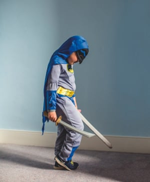 Tom dressed as batman