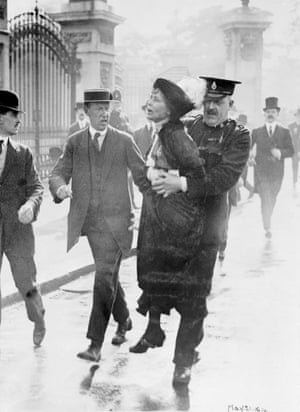 Emmeline Pankhurst being arrested by outside Buckingham Palace, in 1914.