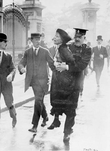 Emmeline Pankhurst being arrested by outside Buckingham Palace, in 1914.