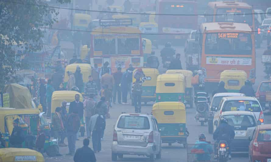 Indian commuters travel on a polluted road near a bus terminus in the Anand Vihar district of New Delhi. Photograph: AFP/Getty