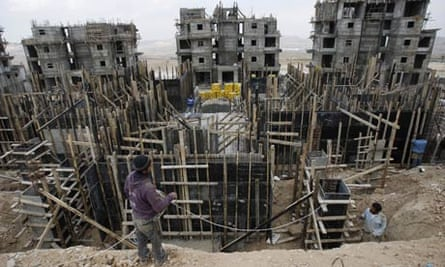 Palestinians labourers work at construction site in Maale Adumim
