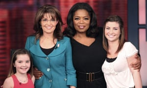 Sarah Palin with her two daughters and talkshow host Oprah Winfrey