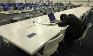 A delegate sleeps at the Copenhagen summit