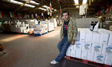 Luuis de Silva sits in the East Enders discount drinks warehouse in Calais, France