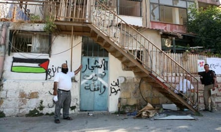 Nasser Ghawi in front of what was his family home