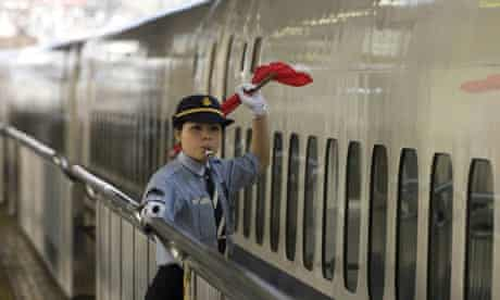 A high-speed train is waved off in Japan