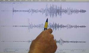 Seismologist examines the earthquake data