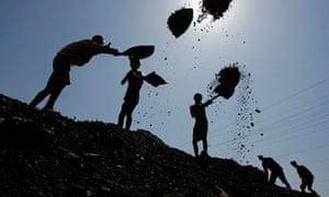 Labourers load coal at Bari Brahamina in Jammu