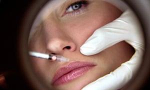 A woman receives a Botox injection