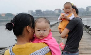 Chinese mothers hold babies in Ganzhou