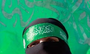 A Palestinian woman wearing a Hamas headband