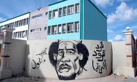 Graffiti showing a caricature of Libyan leader Muammar Gaddafi