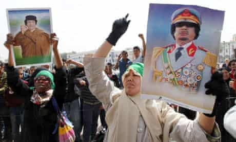 Libyans hold up pictures of Muammar Gaddafi