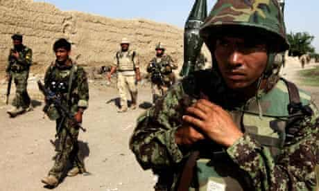 ANA soldier patrols in Arghandab valley near Kandahar