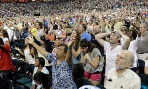 Worshippers in the Reliant stadium