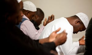 Men praying at a mosque in south-east London