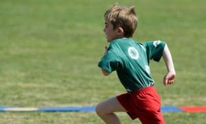 Boy running at school sports day
