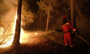 A firefighter works at the site of a wi