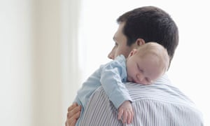 Father holds baby