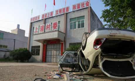 Upturned car in Shangpu, China