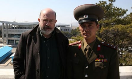 The BBC's John Sweeney poses with a North Korean soldier