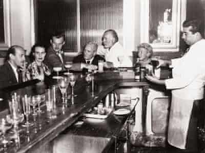 Ernest Hemingway with friends at bar in Havana, Cuba