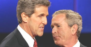 The US president, George Bush, and Democratic candidate John Kerry exchange words at the end of their first televised presidential debate. Photograph: Jim Bourg/Reuters