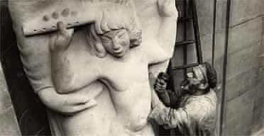 Eric Gill at work on Prospero and Ariel outside the BBC